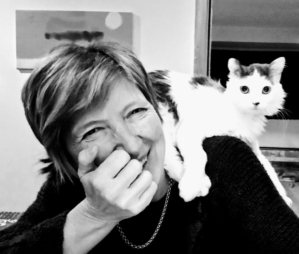 Eilidh Horder and Suki the cat on shoulder B&W