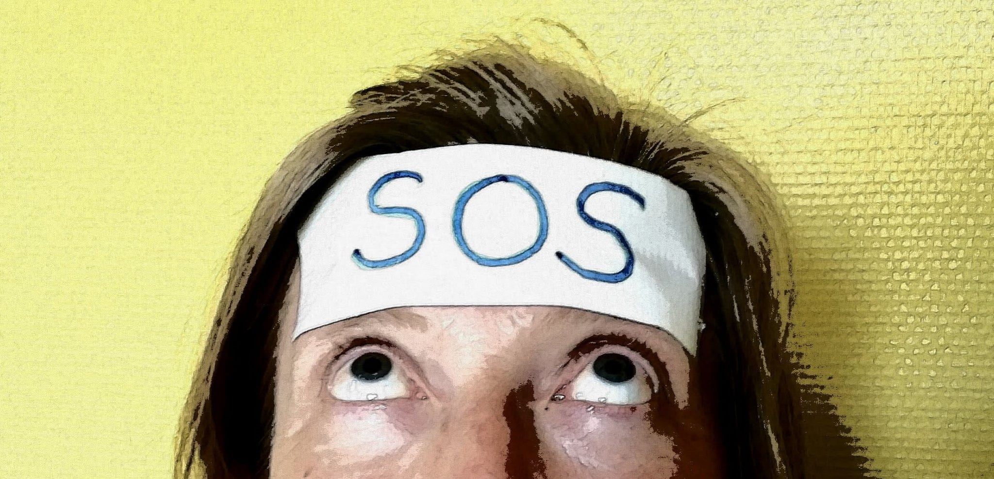 SOS on sticker on woman's forehead