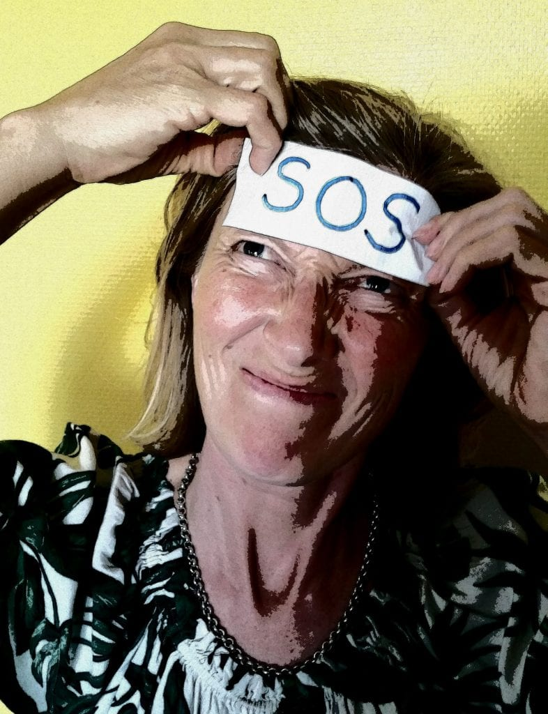 woman ripping off SOS sticker from forehead