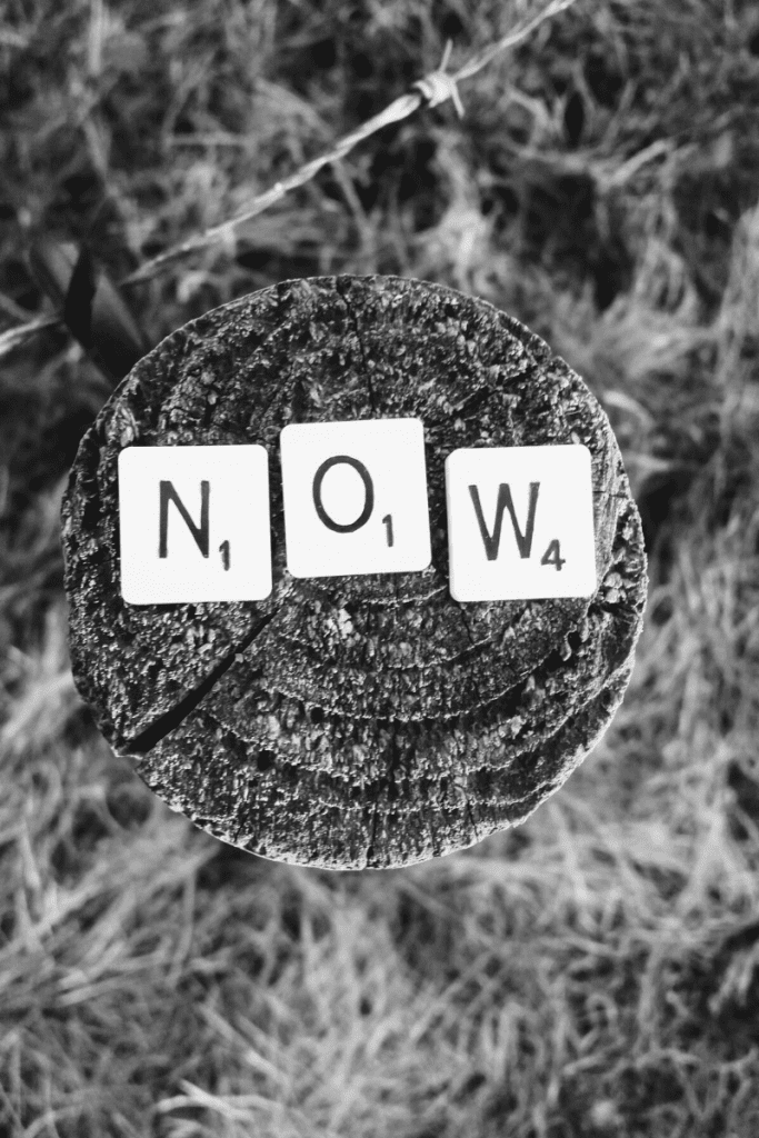 Now in Scrabble letters on wooden fence post